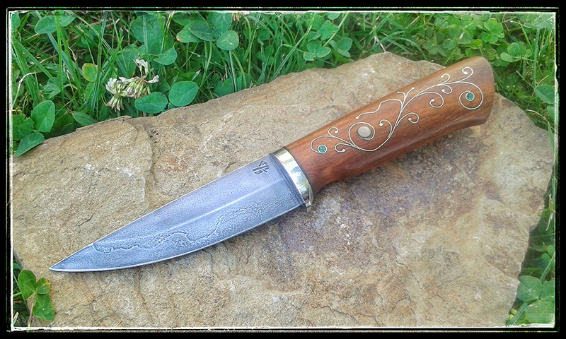 Knife with hand forged silversteel blade 1